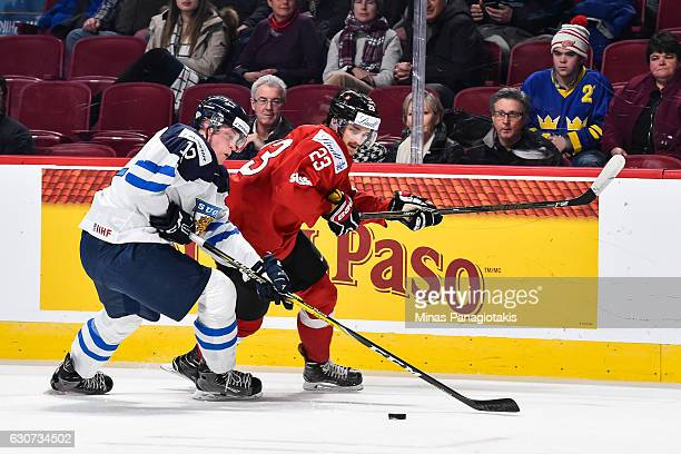 Juuso Valimaki of Team Finland and Dominik Diem of Team Switzerland skate after the puck during the 2017 IIHF World Junior Championship preliminary...