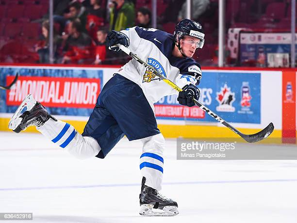 Juuso Valimaki of Team Finland takes a shot during the warmup prior to the IIHF exhibition game against Team Canada at the Bell Centre on December 19...