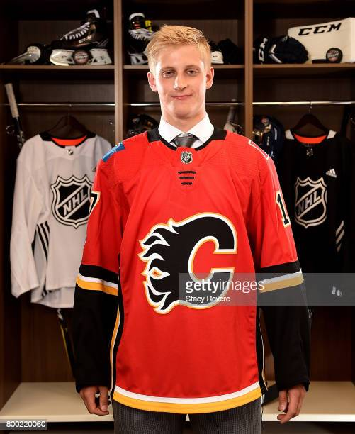 Juuso Valimaki poses for a portrait after being selected 16th overall by the Calgary Flames during the 2017 NHL Draft at the United Center on June 23...
