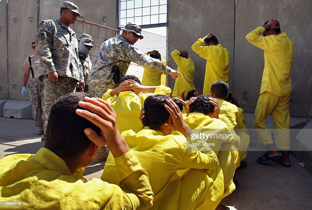 Juvenile detainees are moved along by U.S. Army guards after a bathroom break at the 'House of Wisdom' school near the Camp Cropper detention center September 19, 2007 in Baghdad, Iraq. The U.S. military now has more than 800 juvenile detainees in custody, most of whom were captured during this year's American troop 'surge' in Baghdad. They attend six classes - Arabic, Science, Math, History, Civics and English every three days. Many of the detainees, ages 12-17 years old, have been captured while planting roadside bombs or IEDs targeting U.S. forces, according to military officials.