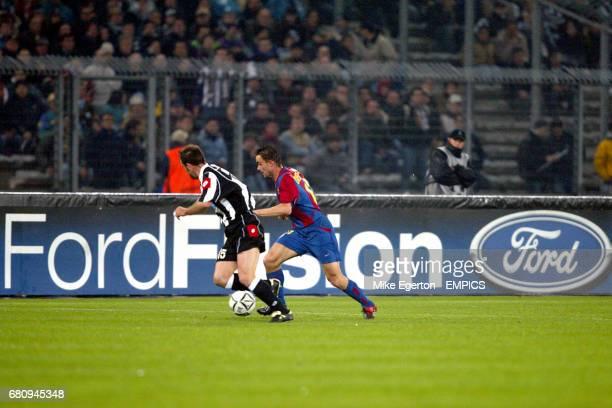 Juventus' Alessandro Birindelli challenges Barcelona's Mark Overmars