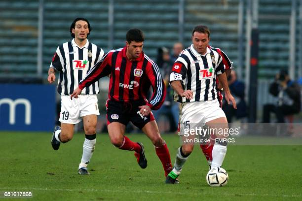 Juventus' Alessandro Birindelli goes past Bayer Leverkusen's Michael Ballack watched by teammate Gianluca Zambrotta