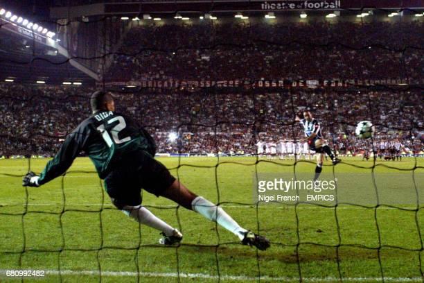 Juventus' Alessandro Birindelli shoots the ball as AC Milan goalkeeper Dida dives the wrong way