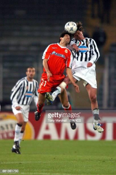 Juventus' Alessandro Tacchinardi clashes with Deportivo La Coruna's Juan Valeron