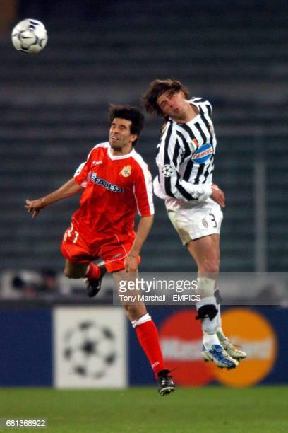 Juventus' Alessio Tacchinardi and Deportivo La Coruna's Juan Valeron jump for the header