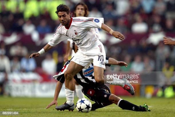 Juventus' Antonio Conte tackles AC Milan's Rui Costa