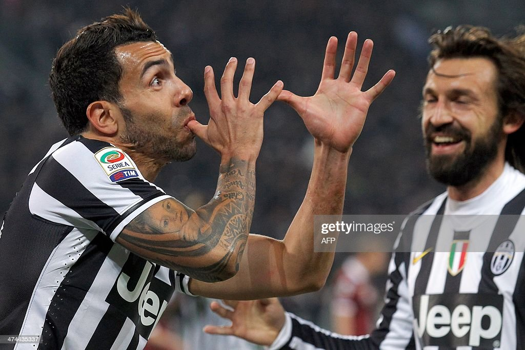Juventus' Argentine forward Carlos Tevez celebrates after scoring during the Italian Serie A football match between Juventus and Torino on February 23, 2014 at Juventus Stadium in Turin. AFP PHOTO / MARCO BERTORELLO