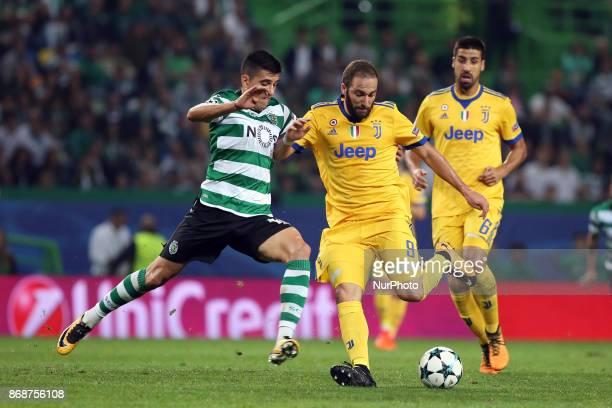 Juventus' Argentine forward Gonzalo Higuain vies with Sporting's midfielder Rodrigo Battaglia from Argentina during the UEFA Champions League...