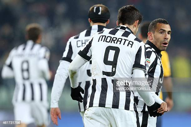 Juventus' Argentinian forward Alberto Carlos Tevez celebrates with Juventus' Spanish forward Alvaro Morata after scoring a goal during the Italian...