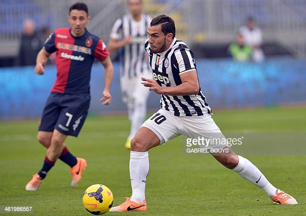 Juventus' Argentinian forward Carlos Tevez runs with the ball during the Italian Serie A football match between Cagliari and Juventus on January 12...