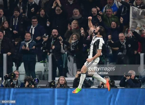 Juventus' Argentinian forward Gonzalo Gerardo Higuain celebrates after scoring a goal during the Italian Serie A football match between Juventus and...