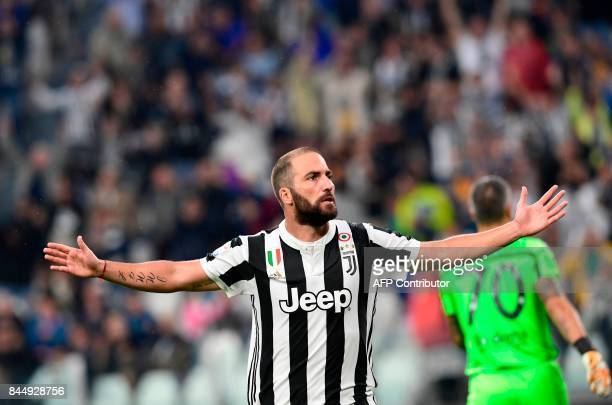 Juventus' Argentinian forward Gonzalo Gerardo Higuain celebrates after scoring during the Italian Serie A football match Juventus vs Chievo at the...