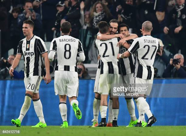 Juventus' Argentinian forward Gonzalo Gerardo Higuain celebrates with teammates after scoring a goal during the Italian Serie A football match...