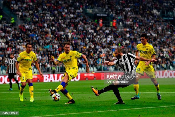 Juventus' Argentinian forward Gonzalo Gerardo Higuain kicks the ball during the Italian Serie A football match Juventus vs Chievo at the Allianz...