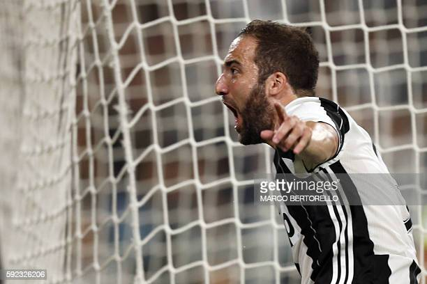 Juventus' Argentinian forward Gonzalo Higuain celebrates after scoring a goal during the Italian Serie A football match between Juventus and...