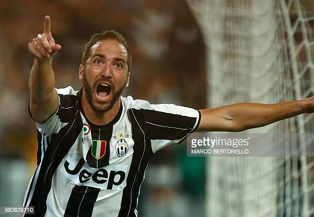 Juventus' Argentinian forward Gonzalo Higuain celebrates after scoring during the Italian Serie A football match Juventus versus Fiorentina on August...