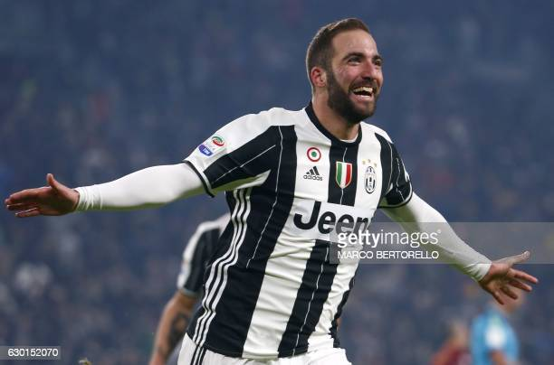 TOPSHOT Juventus' Argentinian forward Gonzalo Higuain celebrates after scoring a goal during the Italian Serie A football match between Juventus and...