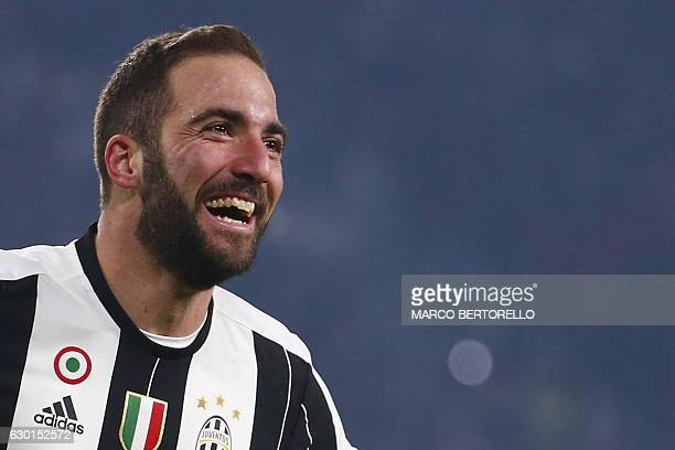 Juventus' Argentinian forward Gonzalo Higuain celebrates after scoring a goal during the Italian Serie A football match between Juventus and As Roma...