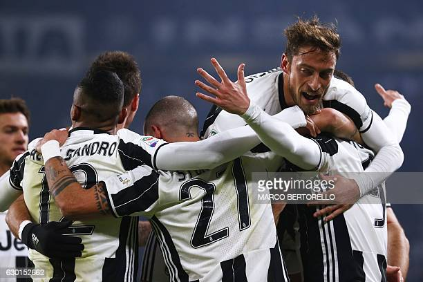 Juventus' Argentinian forward Gonzalo Higuain celebrates after scoring a goal with his teammates during the Italian Serie A football match between...