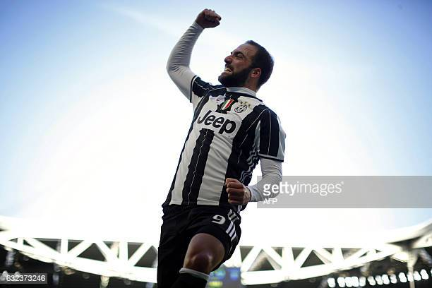 TOPSHOT Juventus' Argentinian forward Gonzalo Higuain celebrates after scoring a goal during the Italian Serie A football match Juventus versus Lazio...