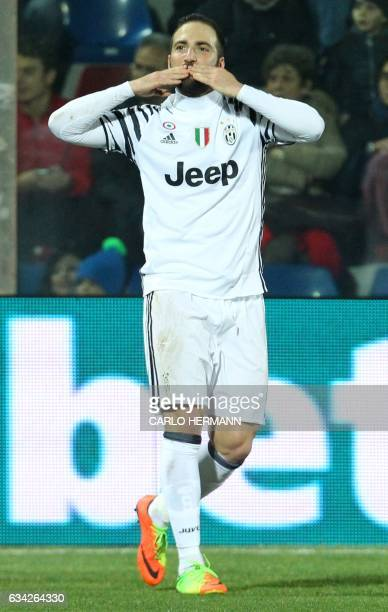 Juventus' Argentinian forward Gonzalo Higuain celebrates after scoring a goal during the Italian Serie A football match FC Crotone vs Juventus FC on...