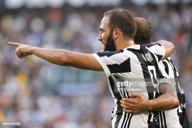 Juventus' Argentinian forward Gonzalo Higuain celebrates after scoring a goal during the Italian Serie A football match Juventus vs Cagliari on...