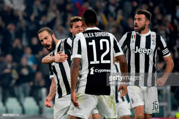 Juventus' Argentinian forward Gonzalo Higuain celebrates with teammates after scoring during the Italian Serie A football match Juventus vs Spal at...