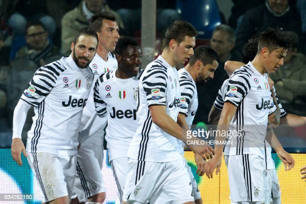 Juventus' Argentinian forward Gonzalo Higuain celebrates with teammates during the Italian Serie A football match between FC Crotone and Juventus FC...