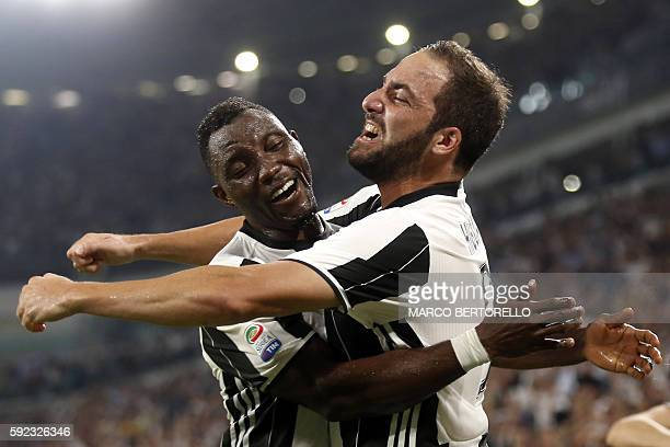 Juventus' Argentinian forward Gonzalo Higuain celebrates with his teammate Juventus' Ghanaian midfielder Kwadwo Asamoah after scoring a goal during...