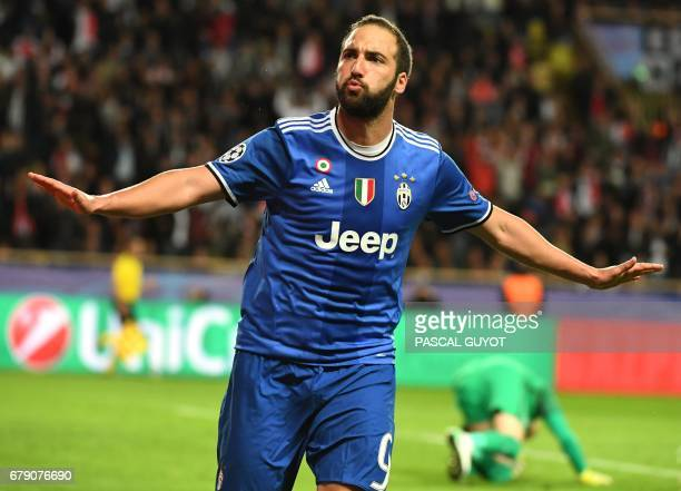 Juventus' Argentinian forward Gonzalo Higuain reacts after scoring a second goal during the UEFA Champions League semifinal first leg football match...