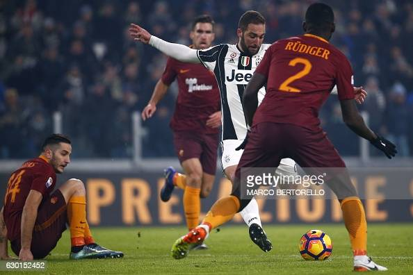 Juventus' Argentinian forward Gonzalo Higuain scores a goal during the Italian Serie A football match between Juventus and As Roma on December 17...