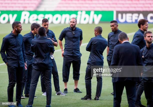 Juventus' Argentinian forward Gonzalo Higuain stands with teammates as they visit the pitch of the Camp Nou stadium in Barcelona on September 11 2017...