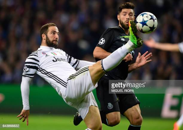 Juventus' Argentinian forward Gonzalo Higuain tries to control the ball next to Porto's Brazilian defender Felipe during the UEFA Champions League...