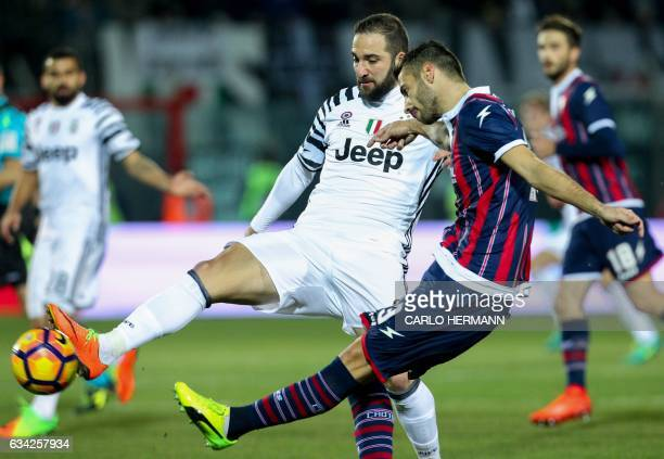 Juventus' Argentinian forward Gonzalo Higuain vies for the ball with Crotone's Italian defender Gian Marco Ferrari during the Italian Serie A...