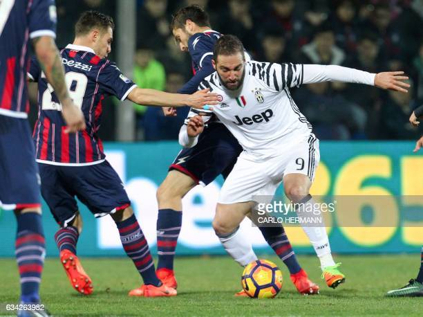 Juventus' Argentinian forward Gonzalo Higuain vies for the ball with Crotone's Italian midfielder Leonardo Capezzi during the Italian Serie A...