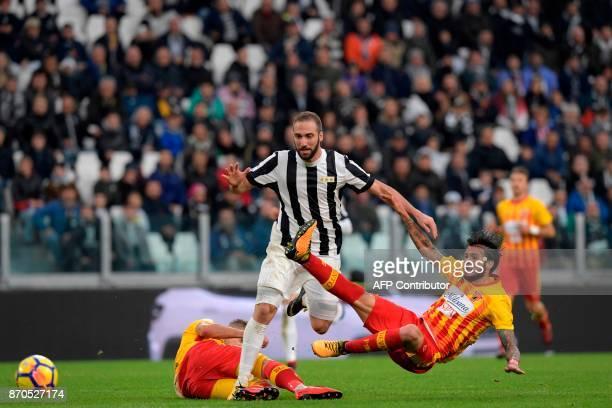 Juventus' Argentinian forward Gonzalo Higuain vies with Benevento's Italian defender Lorenzo Venuti during the Italian Serie A football match...