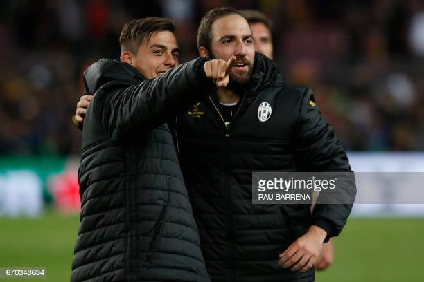 Juventus' Argentinian forward Paulo Dybala and Juventus' Argentinian forward Gonzalo Higuain stand together after the UEFA Champions League...