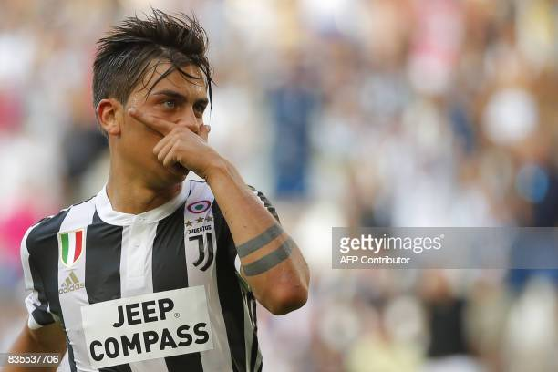 Juventus' Argentinian forward Paulo Dybala celebrates after scoring a goal during the Italian Serie A football match Juventus vs Cagliari on August...