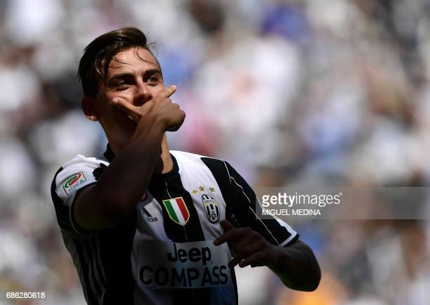 Juventus' Argentinian forward Paulo Dybala celebrates after scoring during the Italian Serie A football match Juventus vs Crotone at the Juventus...