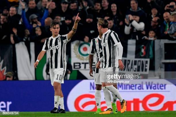 Juventus' Argentinian forward Paulo Dybala celebrates after scoring during the Italian Serie A football match Juventus vs Spal at the Allianz stadium...