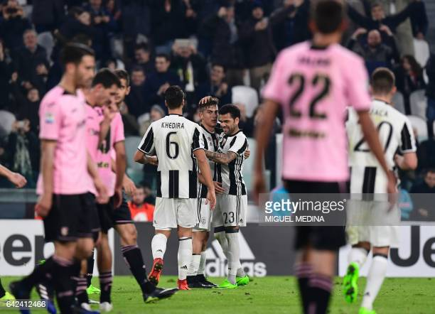 Juventus' Argentinian forward Paulo Dybala is congratulated by Juventus' Brazilian defender Daniel Alvez da Silva after scoring the second goal...