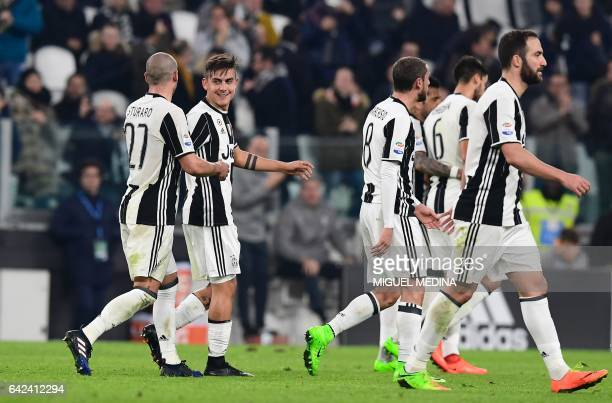 Juventus' Argentinian forward Paulo Dybala is congratulated by Juventus' Italian midfielder Stefano Sturaro after scoring the second goal during the...