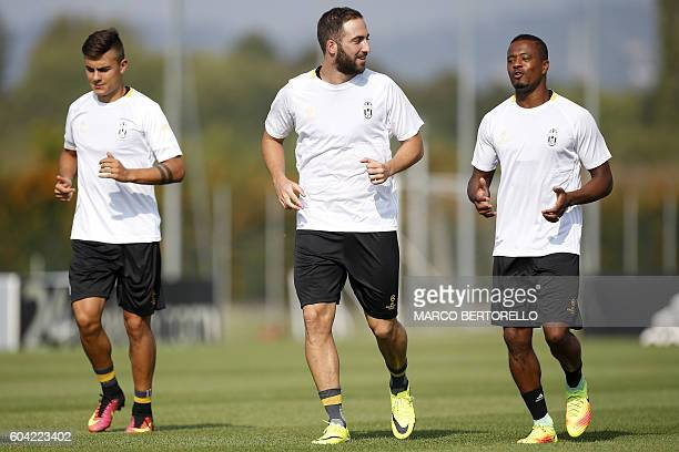 Juventus' Argentinian forward Paulo Dybala Juventus' Argentinian forward Gonzalo Higuain and Juventus' French defender Patrice Evra take part in a...