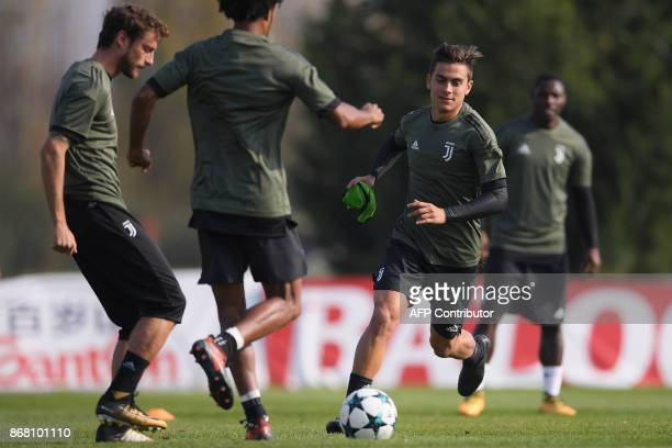 Juventus' Argentinian forward Paulo Dybala takes part in a training session on the eve of the UEFA Champions League football match Sporting CP versus...