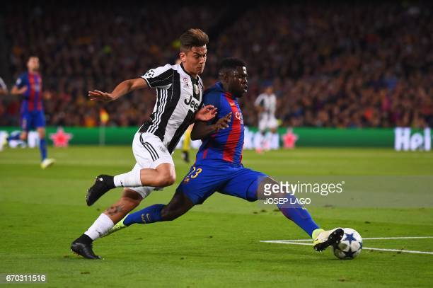 Juventus' Argentinian forward Paulo Dybala vies with Barcelona's French defender Samuel Umtiti during the UEFA Champions League quarterfinal second...