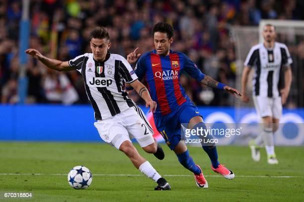 Juventus' Argentinian forward Paulo Dybala vies with Barcelona's Brazilian forward Neymar during the UEFA Champions League quarterfinal second leg...