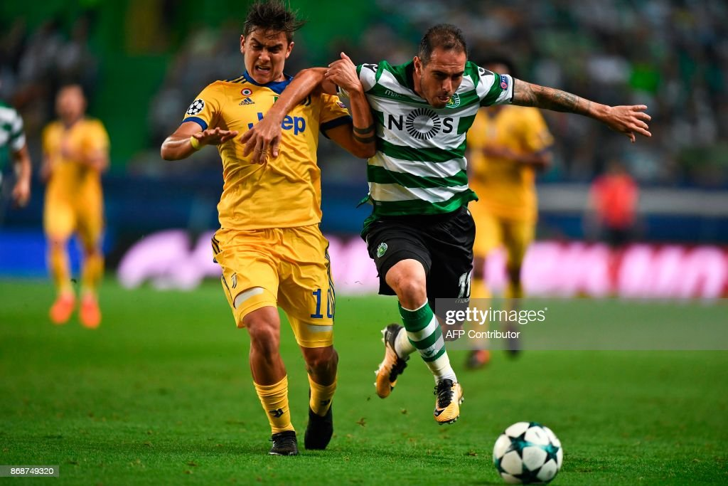 Juventus' Argentinian forward Paulo Dybala (L) vies with Sporting's Brazilian midfielder Bruno Cesar (R) during the Champions League, Group D, football match Sporting CP vs Juventus FC at Alvalade stadium in Lisbon on October 31, 2017. /