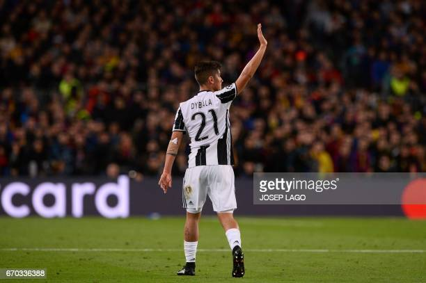 Juventus' Argentinian forward Paulo Dybala waves his supporters as he leaves the pitch during the UEFA Champions League quarterfinal second leg...