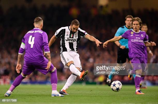 Juventus' Argentinian striker Gonzalo Higuain hits a shot early in the UEFA Champions League final football match between Juventus and Real Madrid at...