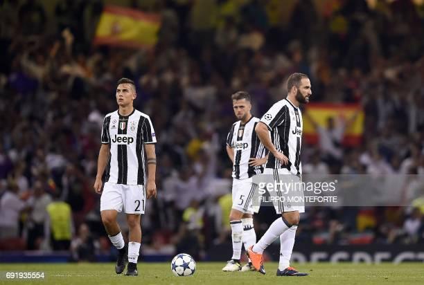 Juventus' Argentinian striker Paulo Dybala Juventus' Bosnian midfielder Miralem Pjanic and Juventus' Argentinian striker Gonzalo Higuain react after...